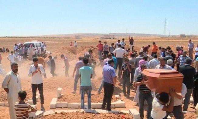 SISTE FARVEL: Rehan Kurdi og hennes sønner Galip (5) og Alan (3) ble begravd i Kobane forrige fredag.