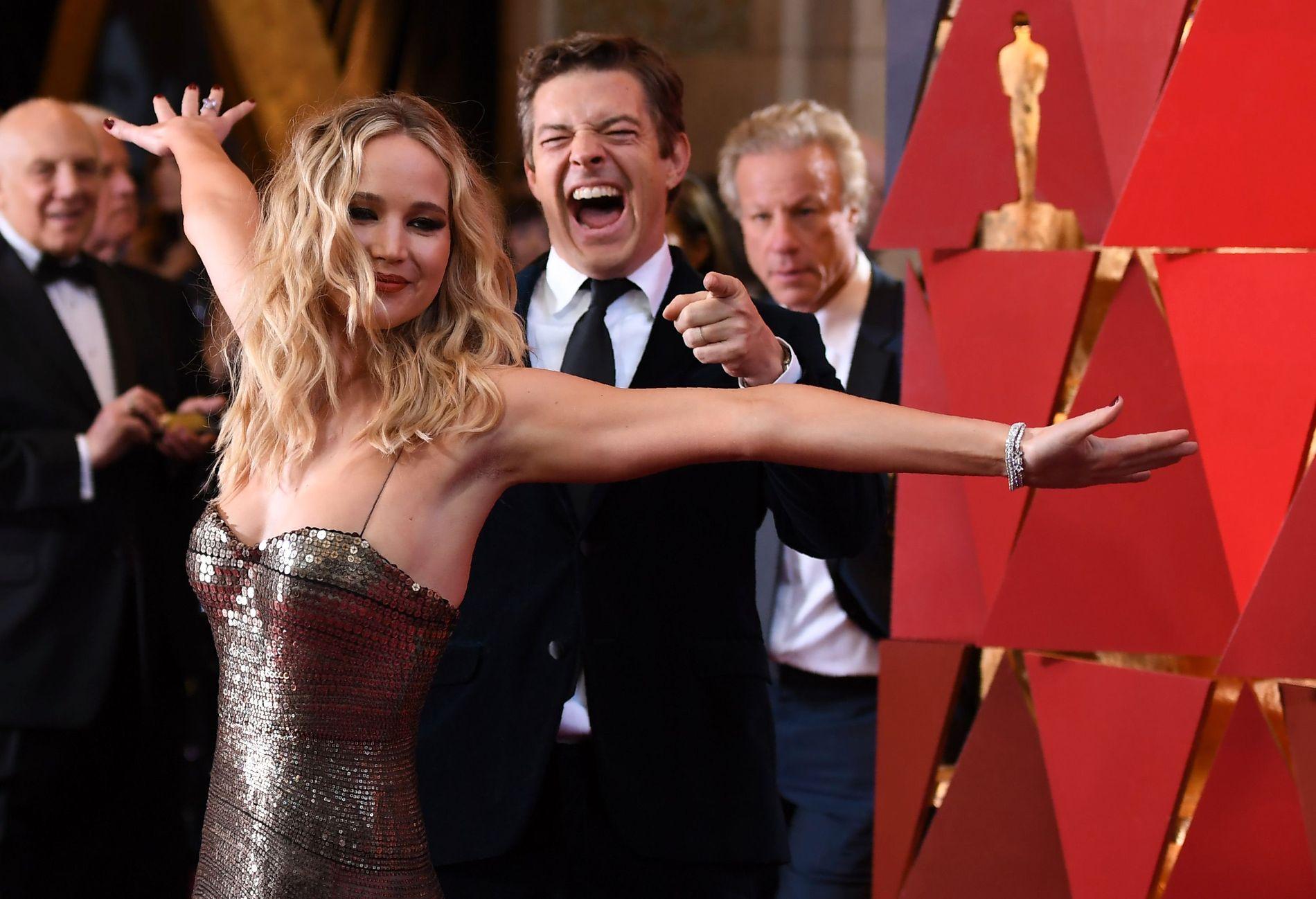 FILMDRONNING: Jennifer Lawrence liker å slå seg løs på rød løper, som her under Oscar-utdelingen i Los Angeles i mars.