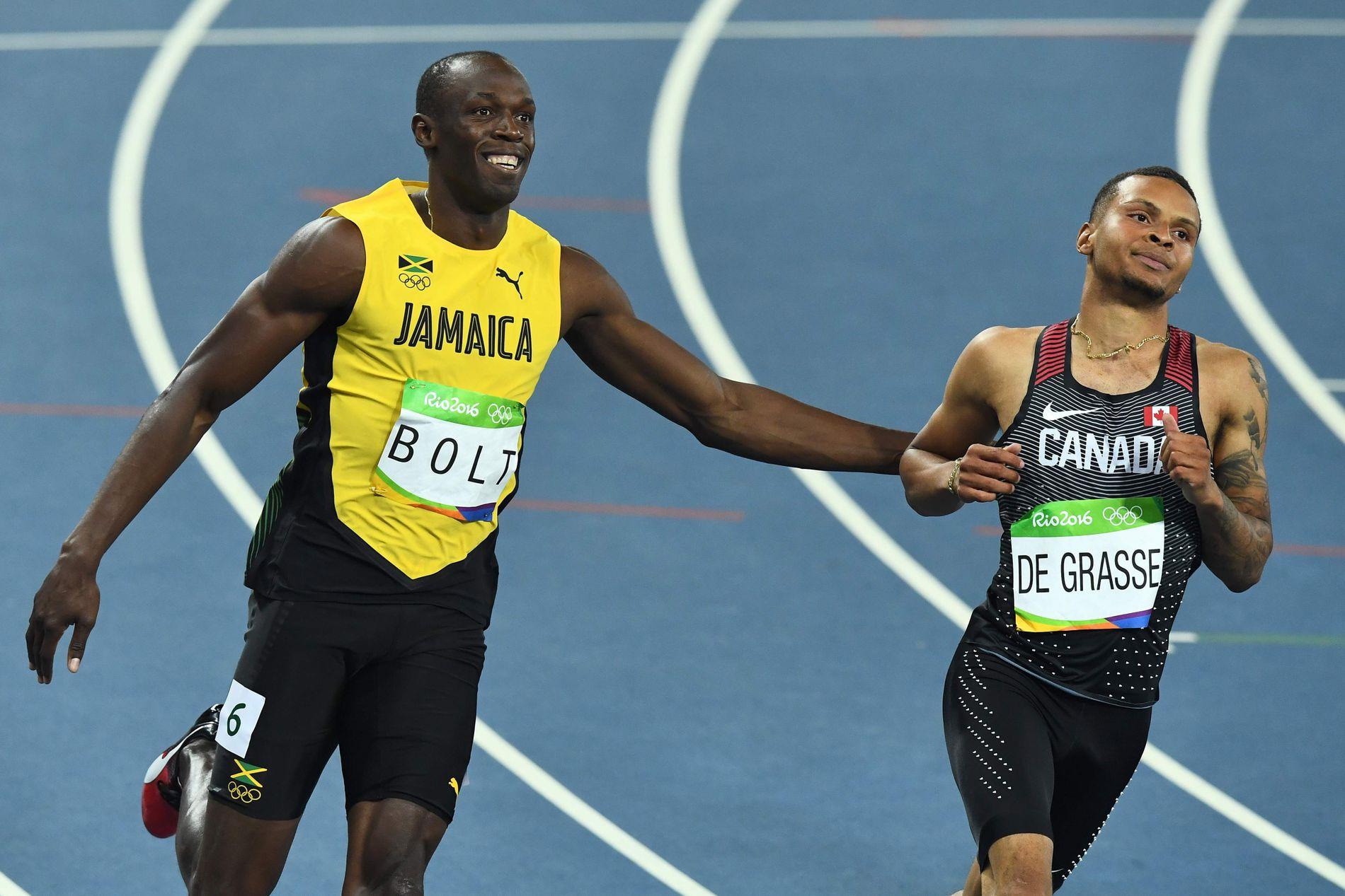 GLISENDE: Det var lekende lett for Usain Bolt i semifinalen. Her sammen med Canadas Andre De Grasse.