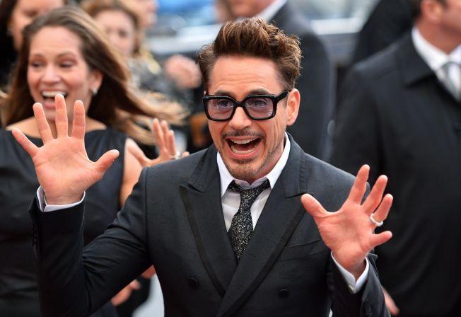 GLAD I PENGER: Robert Downey Jr. stikker av med tittelen «Hollywoods best betalte» nok en gang. Her fra premieren på «Iron Man 3» i fjor, i London.