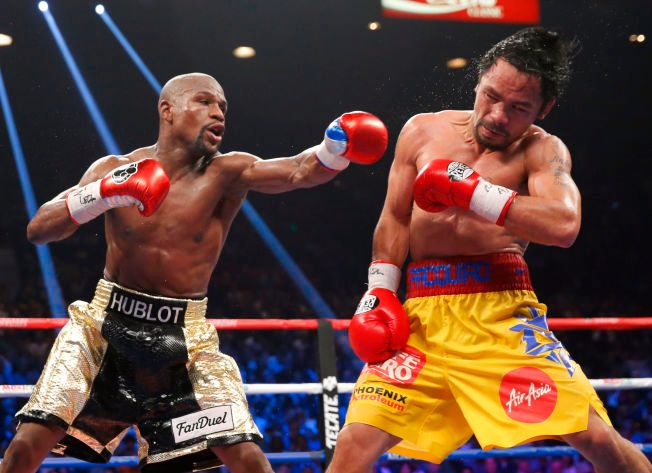 TOPPER LISTEN: Det var stort interesse for k ampen mellom Floyd Mayweather Jr. og Manny Pacquiao verden over i mai, og det ble selvfølgelig også et tema på Facebook. Begge de to bokserne er i toppen av listen over de største idrettsutøverne på nettstedet i år.