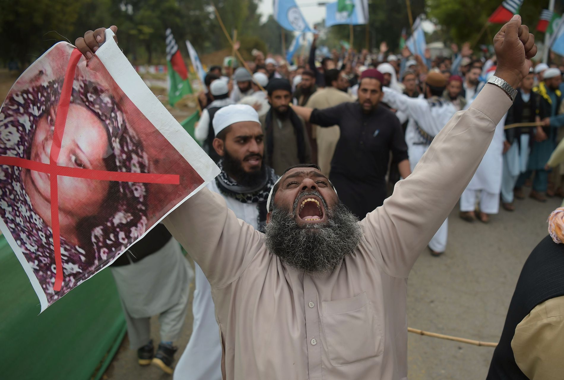 PROTESTER: A religious party supporter, Ahle Sunnat Wal Jamaat (ASWJ), views Bibi's image in a demonstration that was born after the Supreme Court's decision to release Bibi's blasphemy.