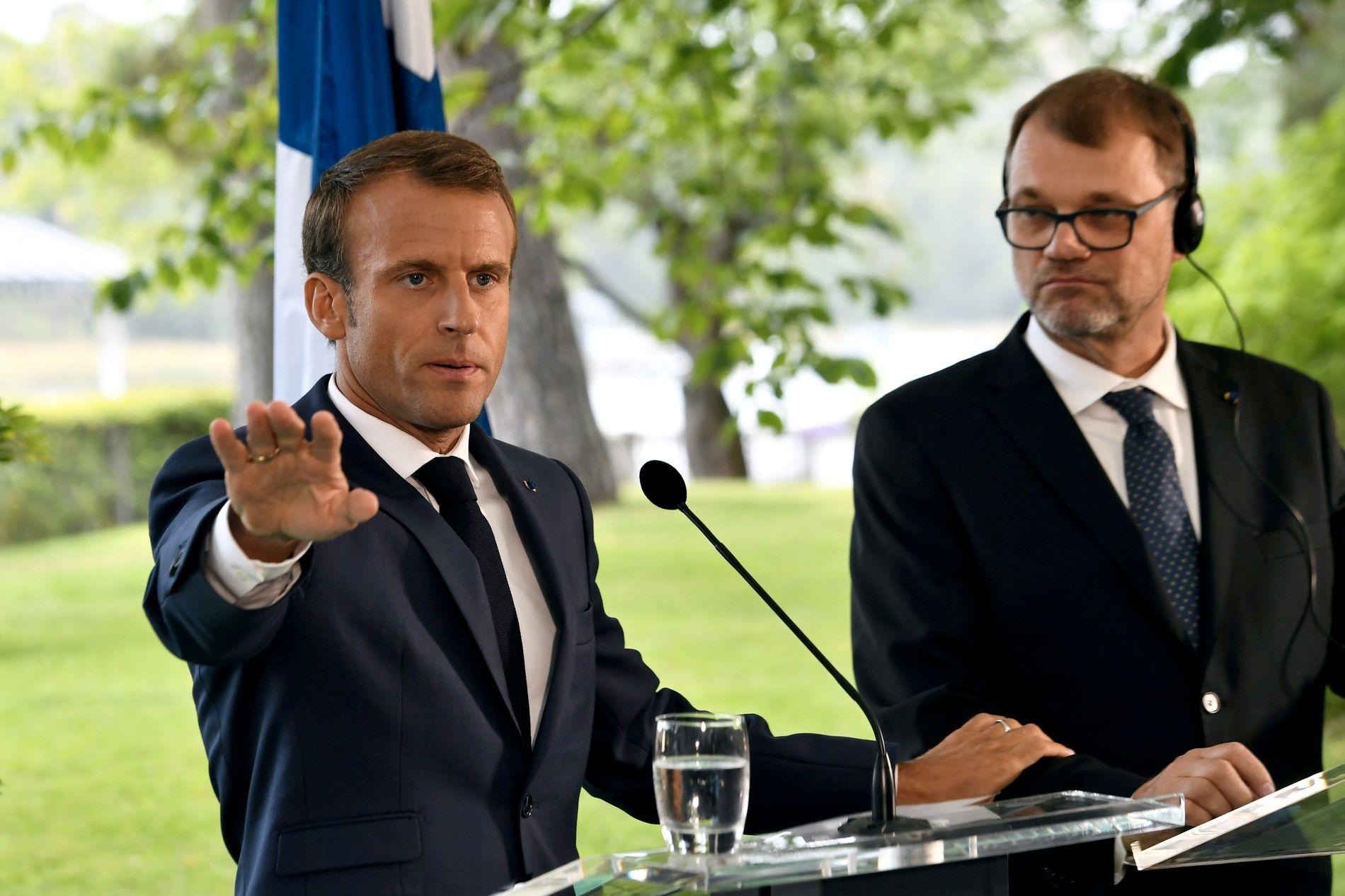 PUNKTERER EU-LØSNING: Frankrikes president Emmanuel Macron møtte sin finske kollega Juha Sipila i Helsingfors torsdag.