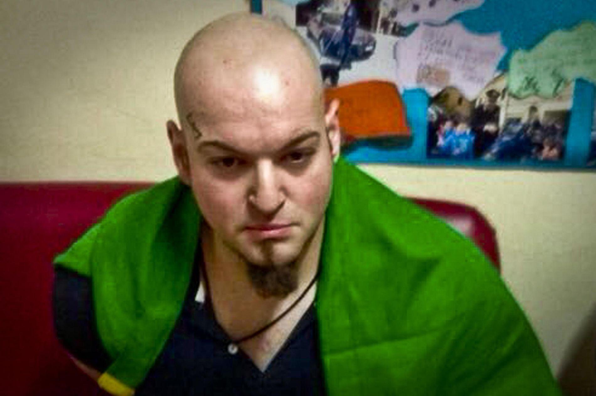 ARRESTERT: 28 år gamle Luca Traini er mistenkt for skytingen i Italia i går. Tatoveringen er synlig over hans høyre øyenbryn.