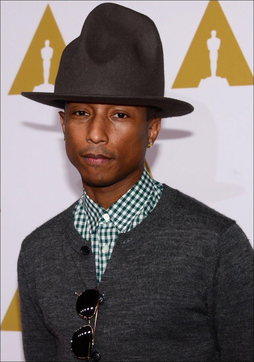 HERRE FOR SIN HATT: Pharrell Williams - her i hatten som har blitt hans varemerke i det siste - har opplevd et formidabelt comeback det siste året, ikke minst i samarbeid med andre. Hans nye soloplate bygger opp under dette og vel så det, ifølge VGs anmelder. Foto: Afp