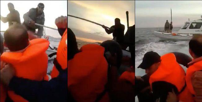 SLÅR MOT GUMMIBÅT: Videon viser at det blir slått mot gummibåten, med det som ser ut til å være lange båthaker.
