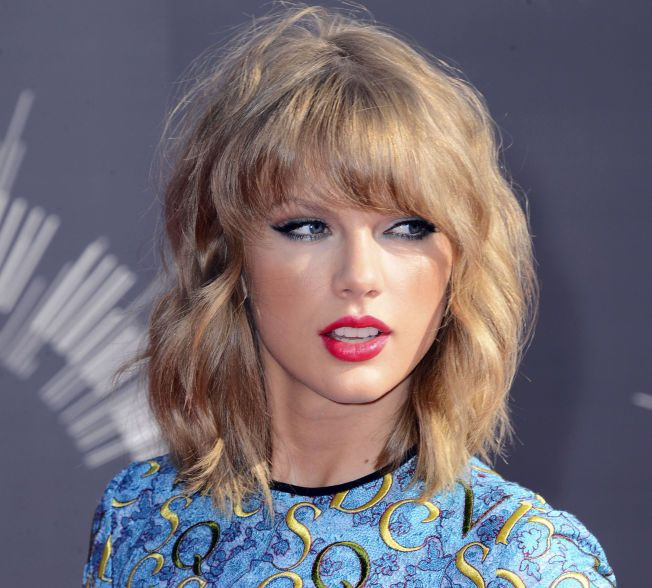 TAR SEG BETALT: Taylor Swift. Foto: AP