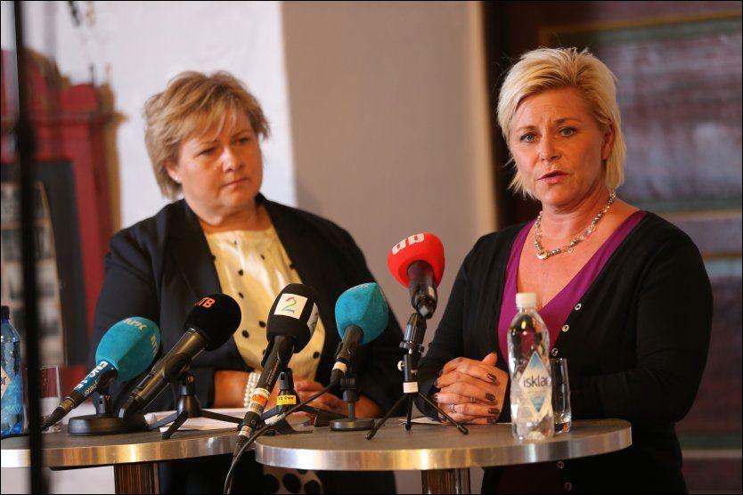 ENIGE: Høyre-leder Erna Solberg og Frp-leder Siv Jensen på en pressekonferanse onsdag ettermiddag. Foto: NTB SCANPIX