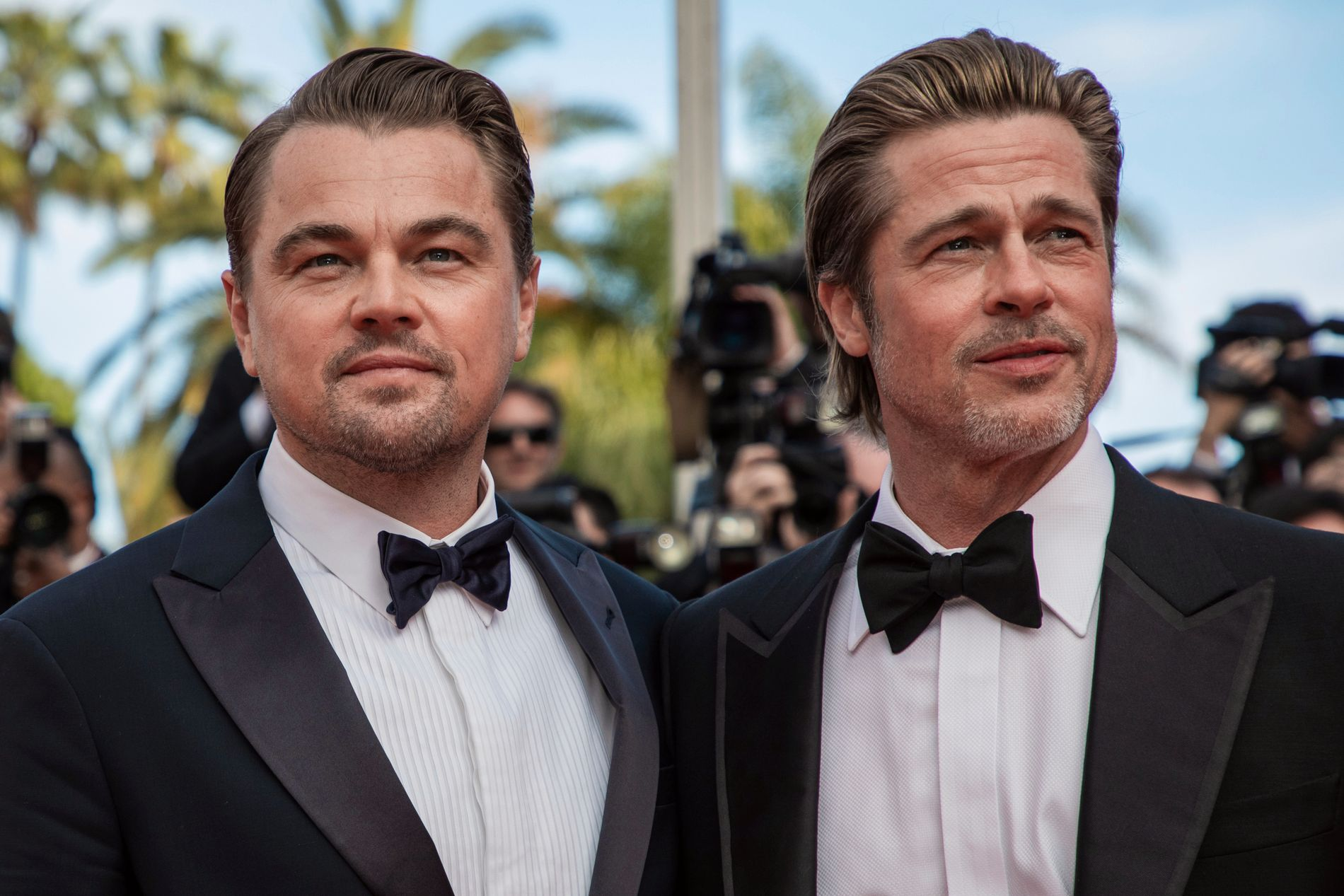 KOLLEGER: Leonardo DiCaprio og Brad Pitt på den røde løperen i Cannes tirsdag kveld.