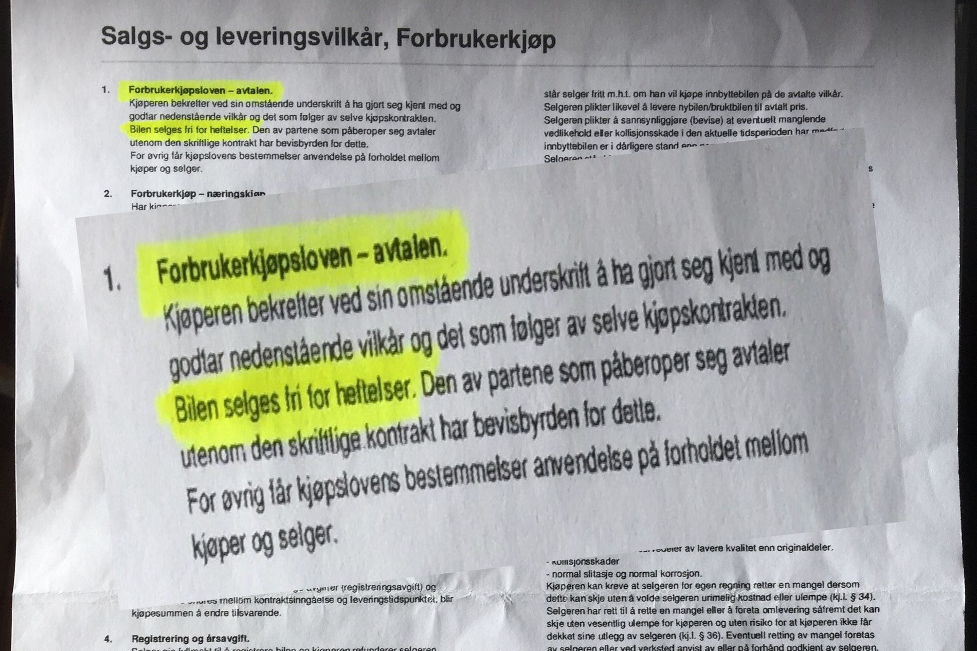 Faksimile fra kjøpsdokument – der står det at bilen er uten heftelser.