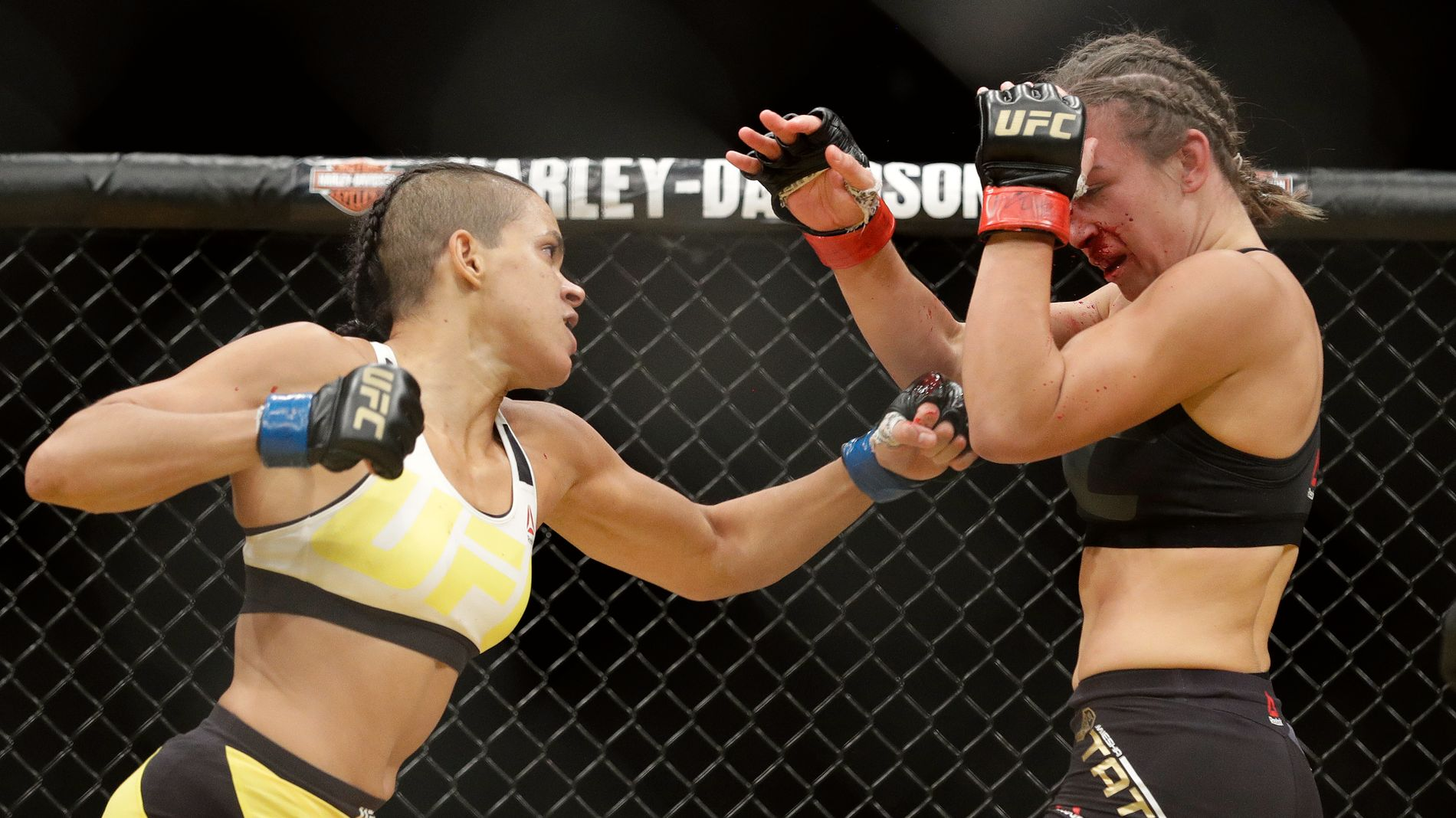 Amanda Nunes, left, fights Miesha Tate during their women's bantamweight championship mixed martial arts bout at UFC 200, Saturday, July 9, 2016, in Las Vegas. (AP Photo/John Locher)