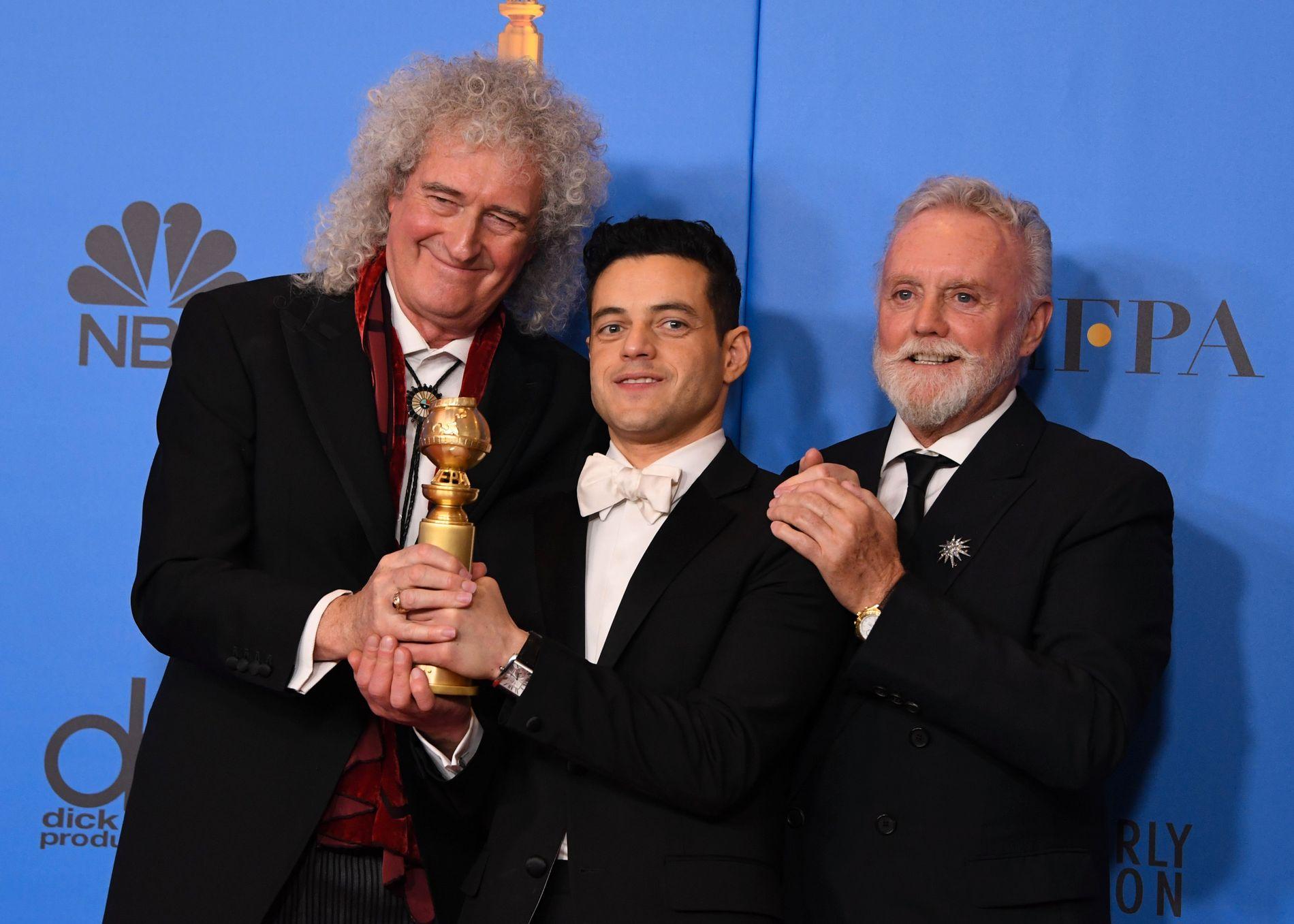 QUEEN-TRIUMF: Rami Malek (i midten) spilte Freddie Mercury i «Bohemian Rhapsody». Her flankert av Queen-medlemmene Brian May (t.v) og Roger Taylor (t.h)