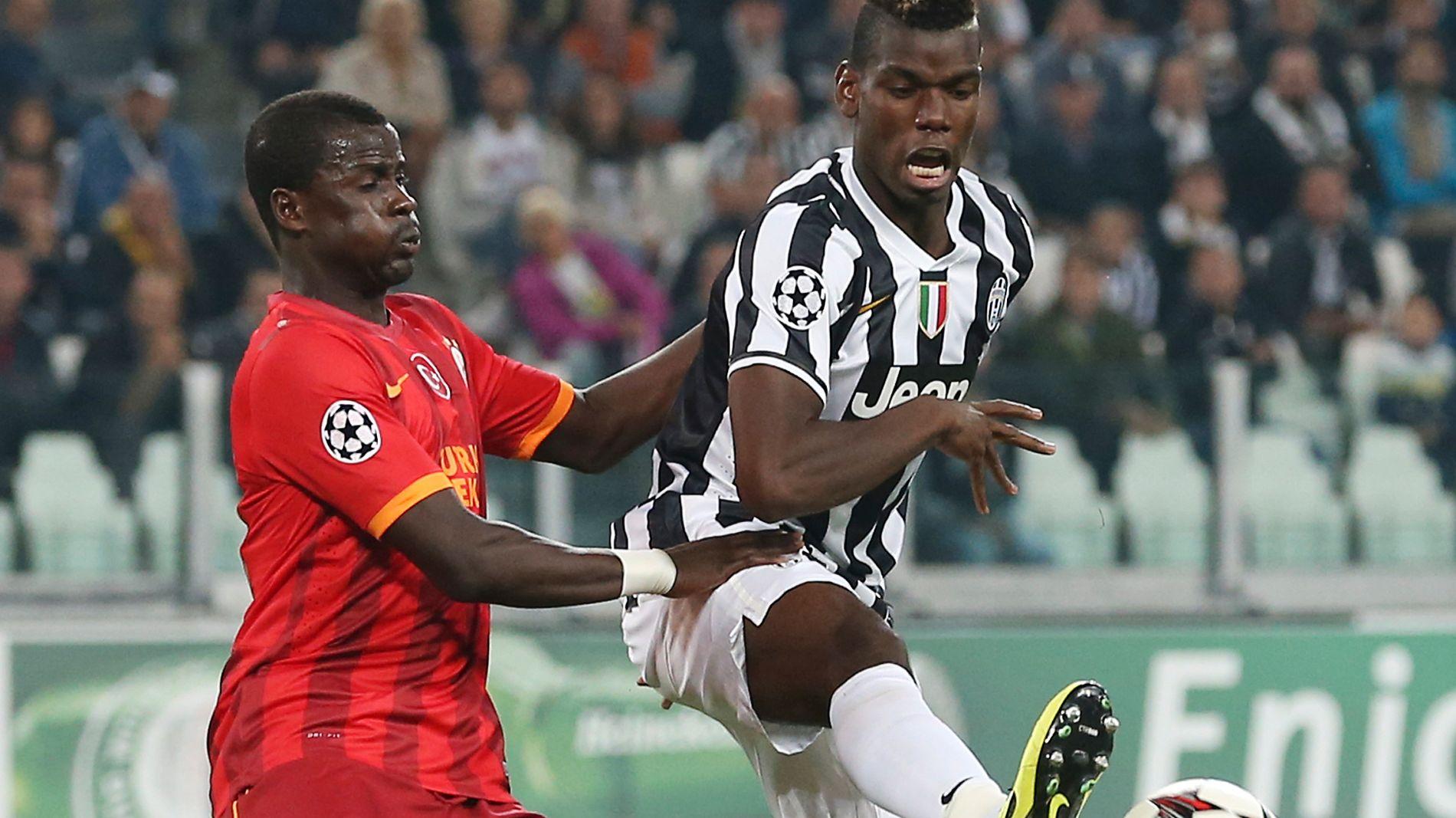 HAR STORE PROBLEMER: Emmanuel Eboue, her i aksjon for Galatasaray mot Juventus og Paul Pogba i 2013, får tilbud om trenerjobb i sin gamle klubb.