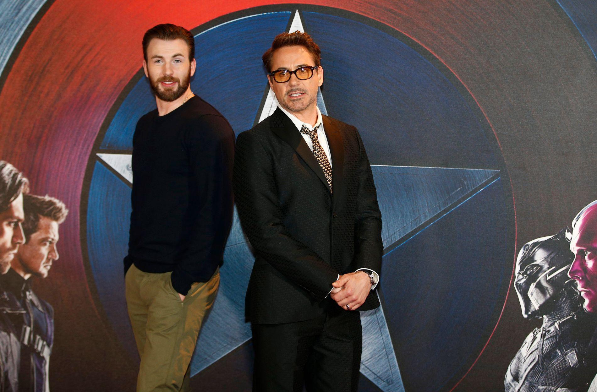 KJEMPER MOT HVERANDRE: De er superhelter begge to, men i «Captain America: Civil War» blir det konflikt mellom Captain America (Chris Evans) og Iron Man (Robert Downey Jr. )