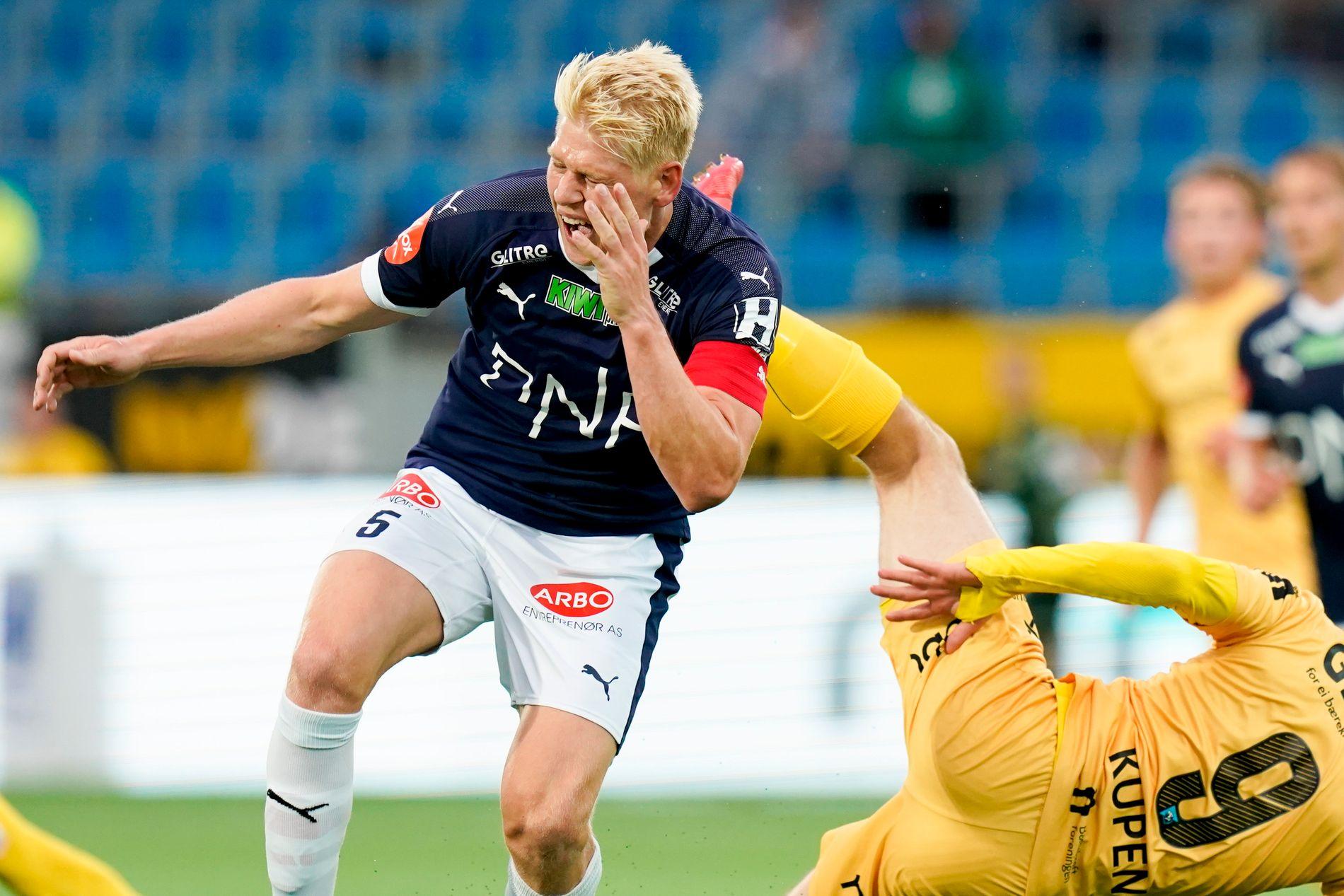 VONDT: Strømsgodset er inne i en tøff periode. Her får kaptein Jakob Glesnes seg en trøkk mot Bodø/Glimt.