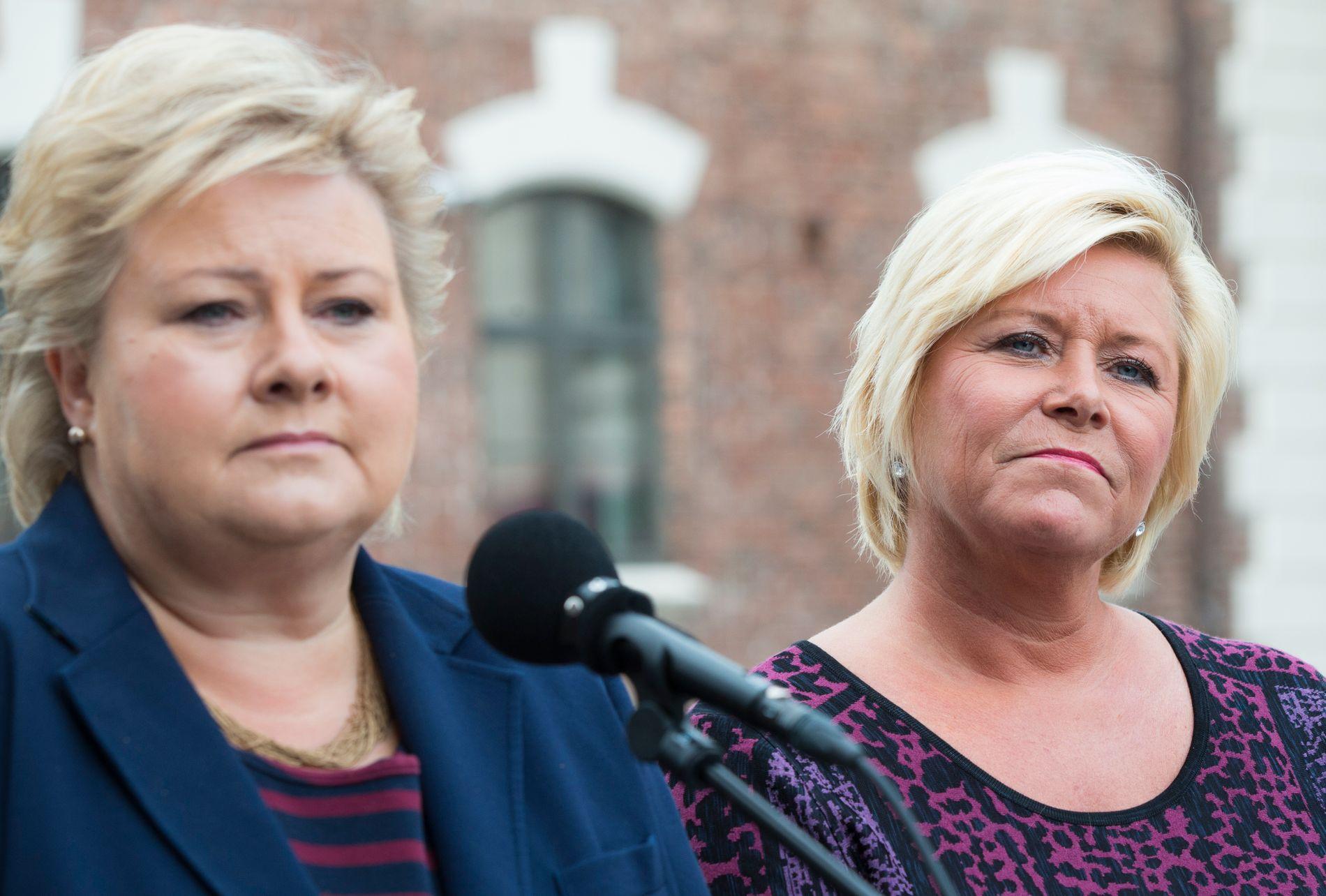 HAR IKKE MER Å GI: Statsminister Erna Solberg (t.v.) og finansminister Siv Jensen, på vei inn til regjeringens budsjettkonferanse i august, presenterer fredag sitt forslag til «det grønne skiftet».