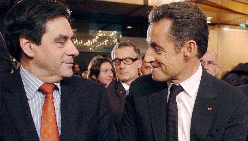 President Nicholas Sarkozy (t.h.) og statsminister Francois Fillon, som ble gjeninnsatt søndag. Foto: AFP.