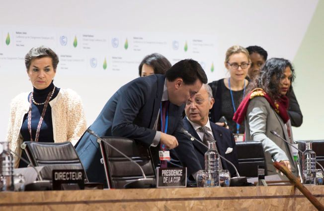 NÆRMERE ENIGHET: Den franske utenriksministeren og presidenten for COP21, Laurent Fabius, presenterte onsdag ettermiddag utkastet til avtale.