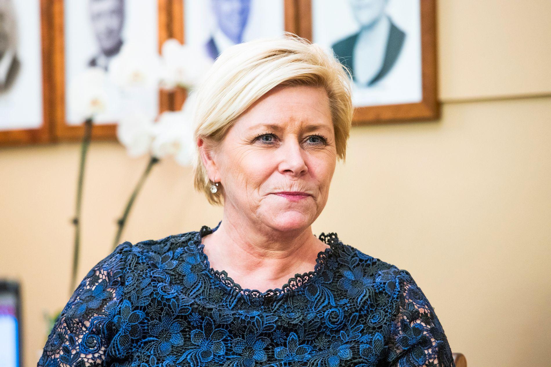 HOLDER FAST: Frp-leder Siv Jensen beholder tyngden med syv statsråder i regjering. KrF og Venstre får tre hver.