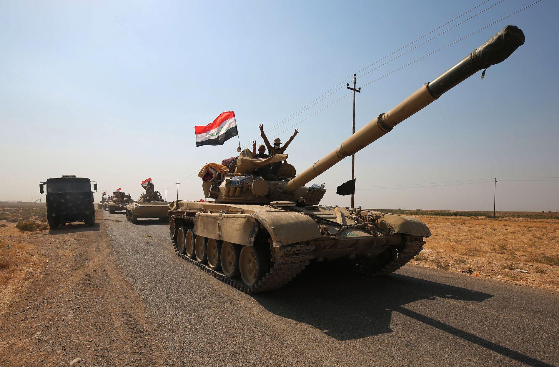 RYKKER INN: Her er irakiske styrker utenfor de omstridte områdene sør for Kirkuk. Bildet er tatt før storoffensiven startet.