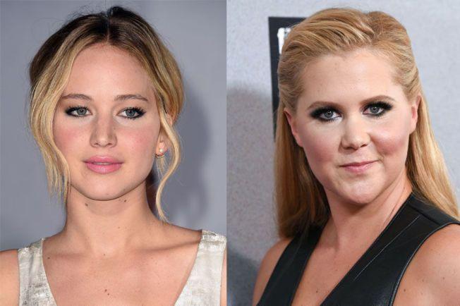 MANUSFORFATTERE?: Skuespiller Jennifer Lawrence (t.v) og komiker Amy Schumer skriver på et manuskript sammen. Ifølge førstnevnte har de to hver sin rolle i komedien de jobber med.