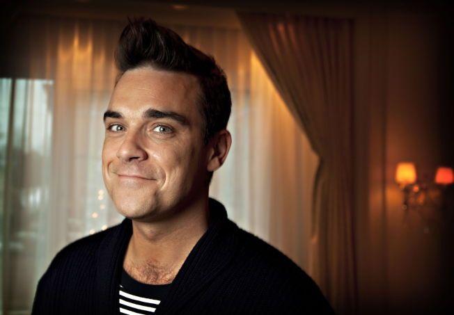 SNART TOBARNSFAR: Robbie Williams og kona Ayda Field lar hele verden følge fødselen av deres andre barn.