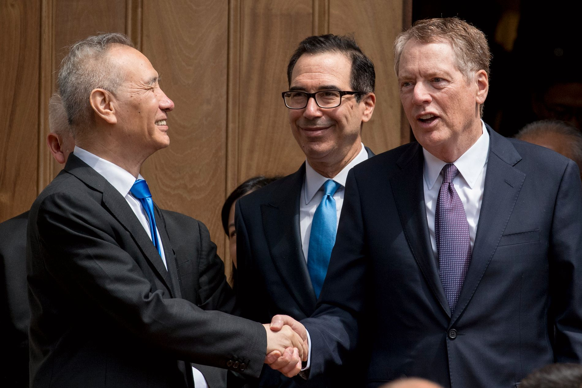 SKAL FORTSETTE SAMTALENE: Kinas visestatsminister Liu He sammen med USAs finansminister Steven Mnuchin og handelsrepresentant Robert Lighthizer.
