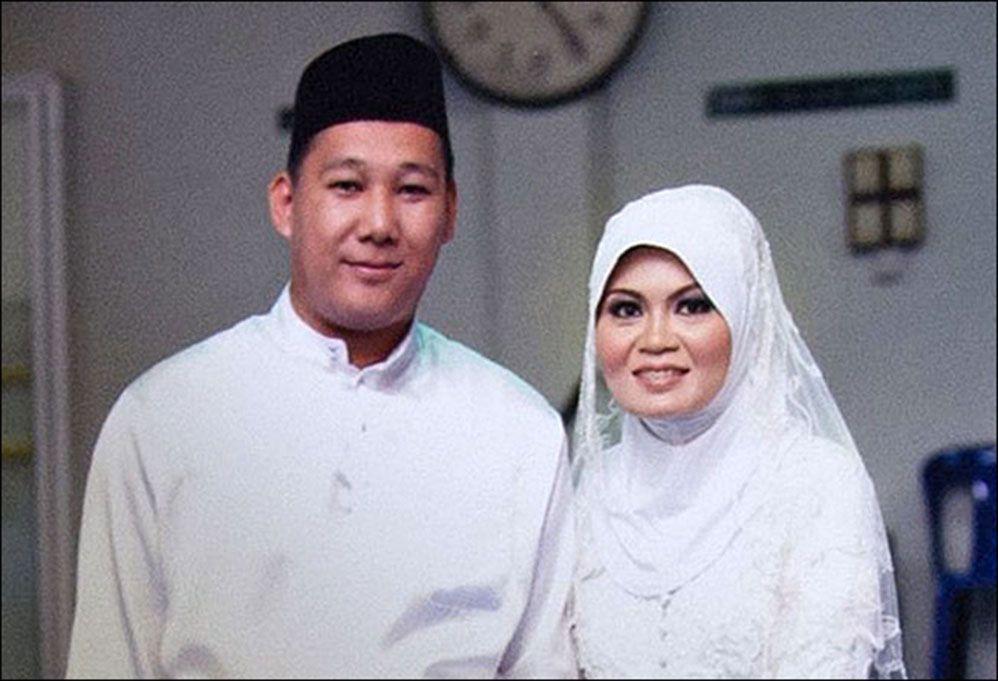SAVNET: Norli Akmar Hamid og Muhammad Razahan Zamani var på vei til Beijing på bryllupsreise da MH370 forsvant. Foto: AFP/PRIVAT
