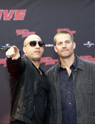 GODE VENNER: Vin Diesel og Paul Walker avbildet i forbindelse med premieren på filmen «Fast Five». Foto: Frank Augstein/AP