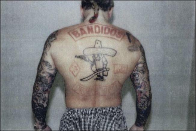 TATOVERT: Selv om Lars Harnes hevder han har levert inn vesten til Bandidos, har han denne tatoveringen på ryggen. For to år siden tvilte Borgarting lagmannsrett på at bruddet var reelt.