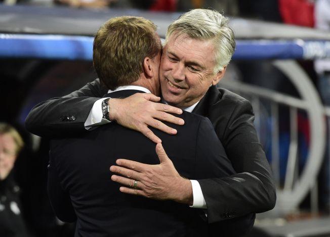 HJERTELIG: Real Madrid-trener Carlo Ancelotti (t.h.) gir Liverpool-kollega Brendan Rodgers en god klem, og takker for kampen på Santiago Bernabeu.